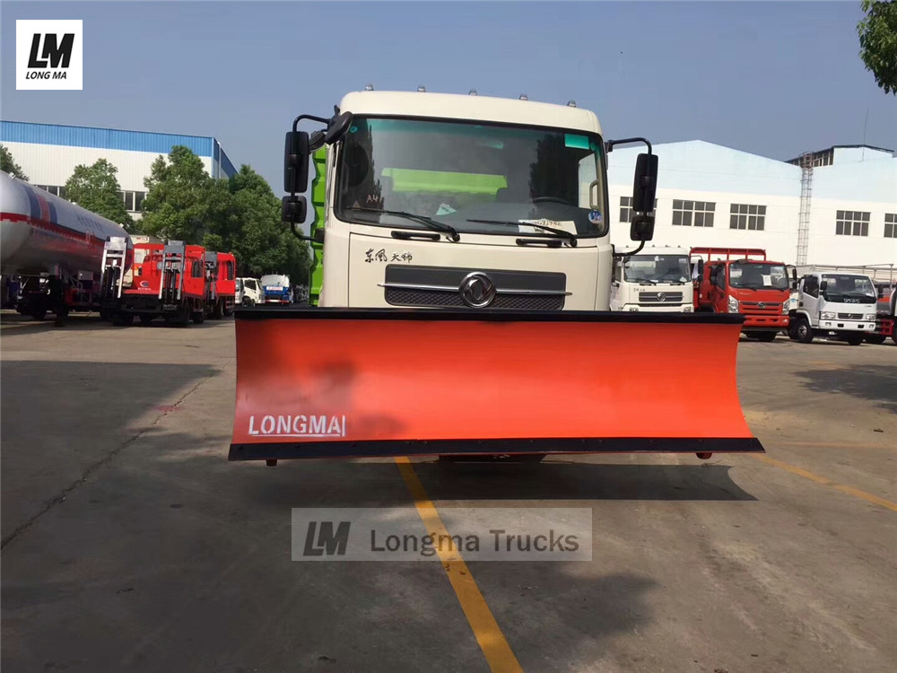 snow plow on road sweeper